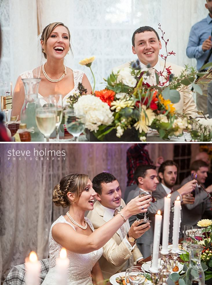 Bride and groom laugh at the head table.jpg
