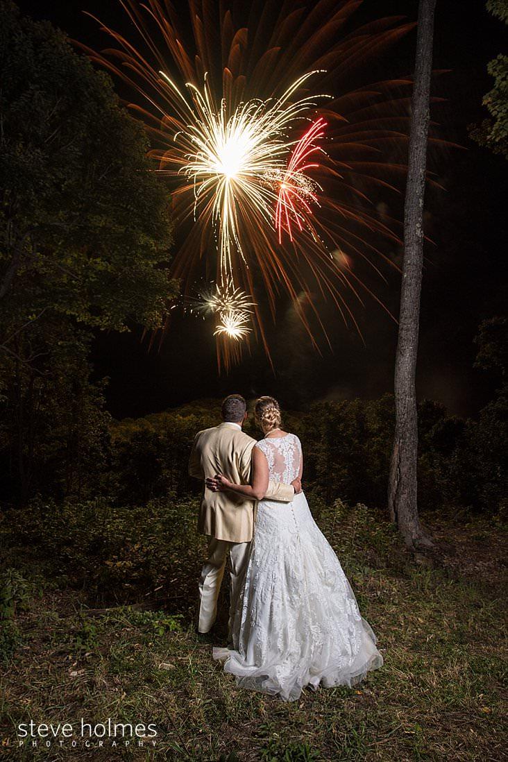 Bride and groom watch fireworks.jpg