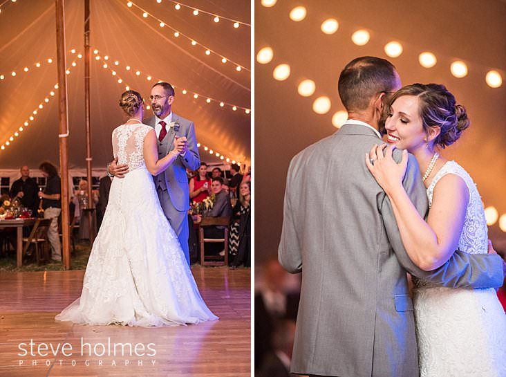 Bride dances with father under white tent.jpg