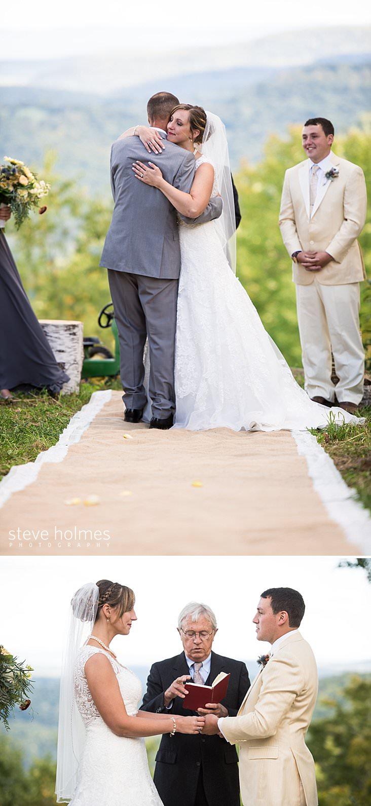 Bride hugs father as groom looks on.jpg