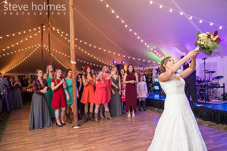Bride tosses bouquet to guests.jpg