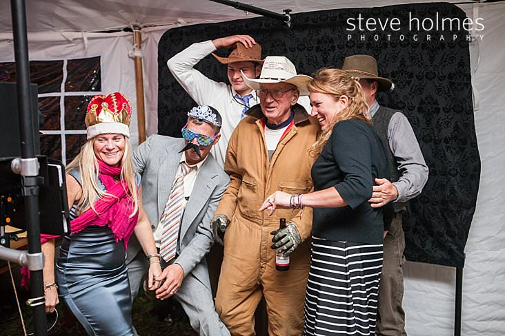 Wedding guests pose for photo booth.jpg