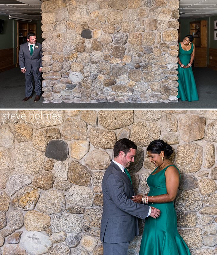 102_Bride and groom peek around corners of stone wall at each other.jpg
