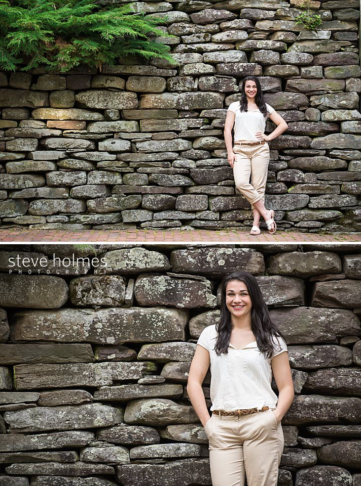 12_Teen girl stands in front of stone foundation wearing khaki pants and white tee shirt.jpg