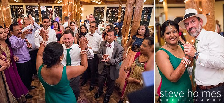 132_Bride and groom are surrounded by guests on dance floor.jpg