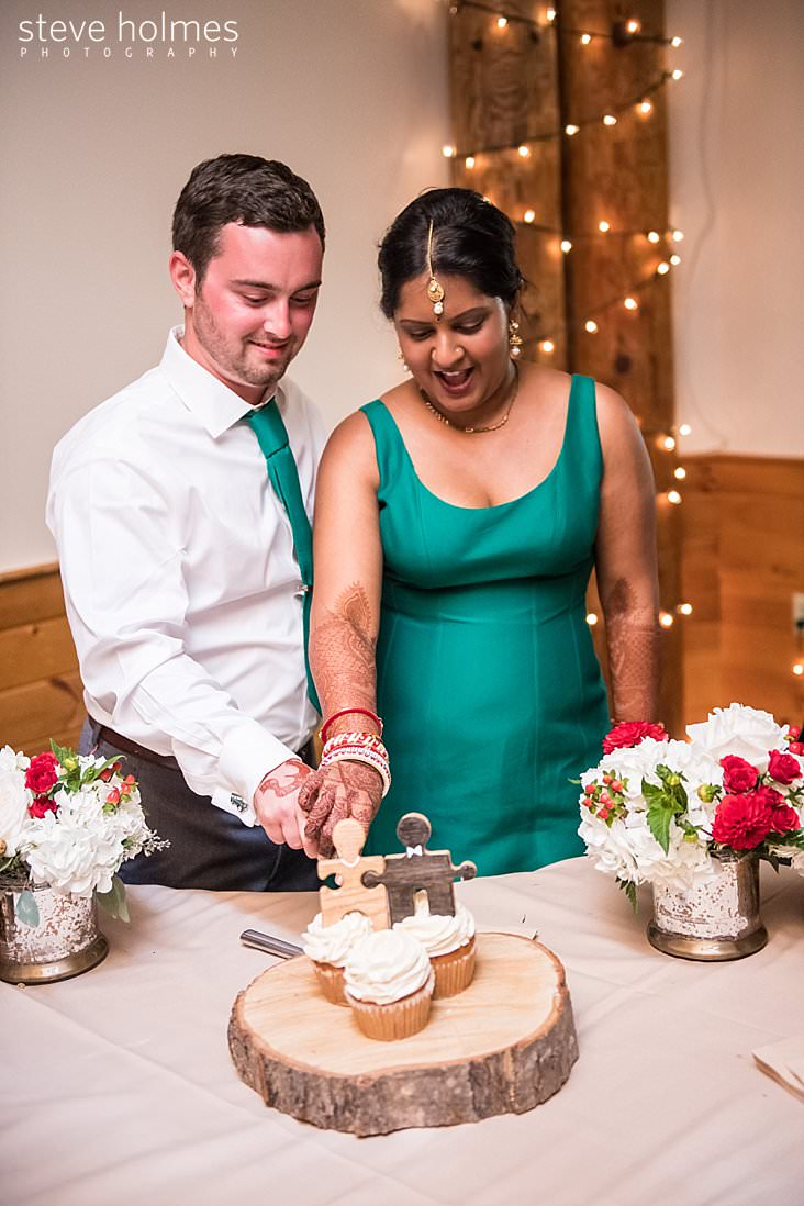 134_Bride and groom cut cupcakes together.jpg