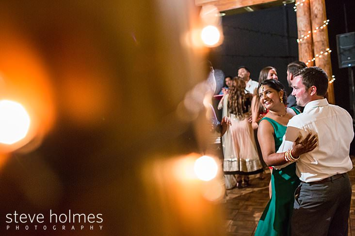 136_Bride and groom dance together during wedding reception.jpg