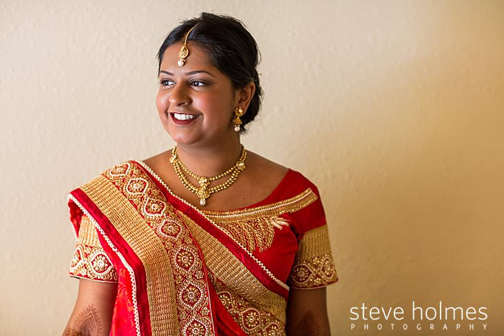 13_Portrait of bride in embroidered red and gold sari.jpg