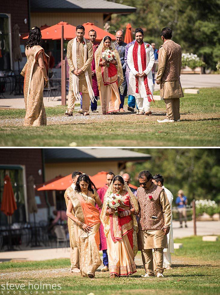 60_Bride in golden veil proceeds towards ceremony.jpg