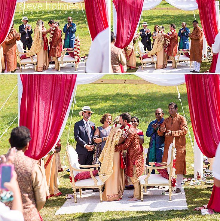 70_Bride places flower chain around groom's neck.jpg
