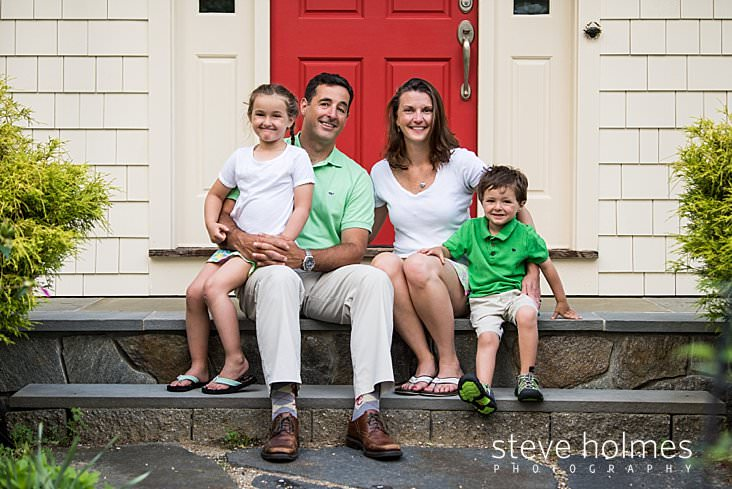 07_A family of four poses for a portrait on their front step_.jpg