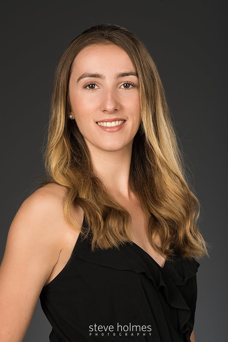 09_Close up of young woman in black dress in studio portrait.jpg