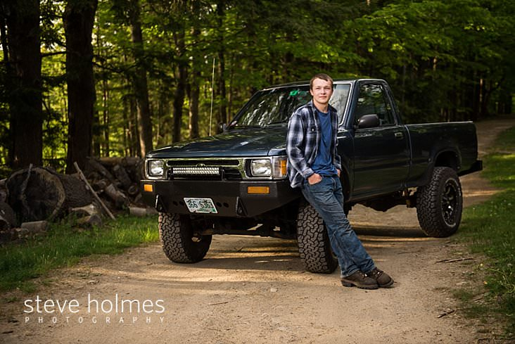 10_Boy leans against his blue truck on country road.jpg