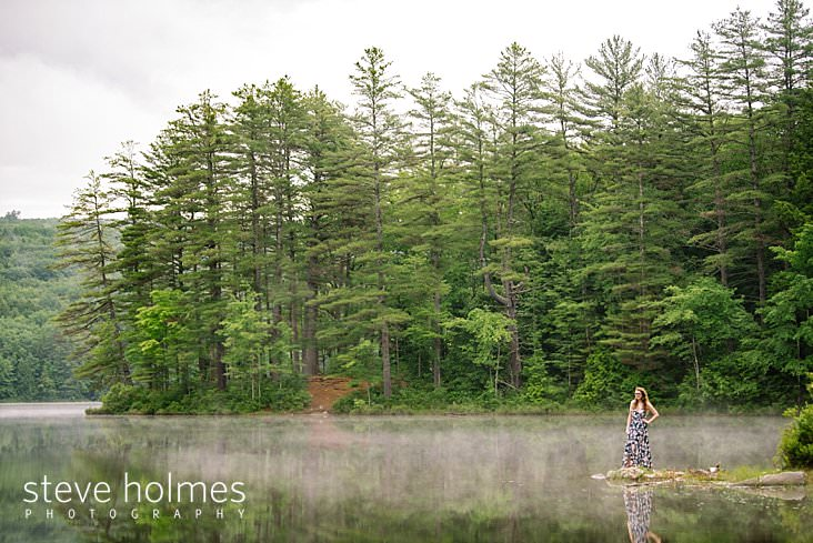 13_Teen girl in dress stands on rock next to misty lake.jpg