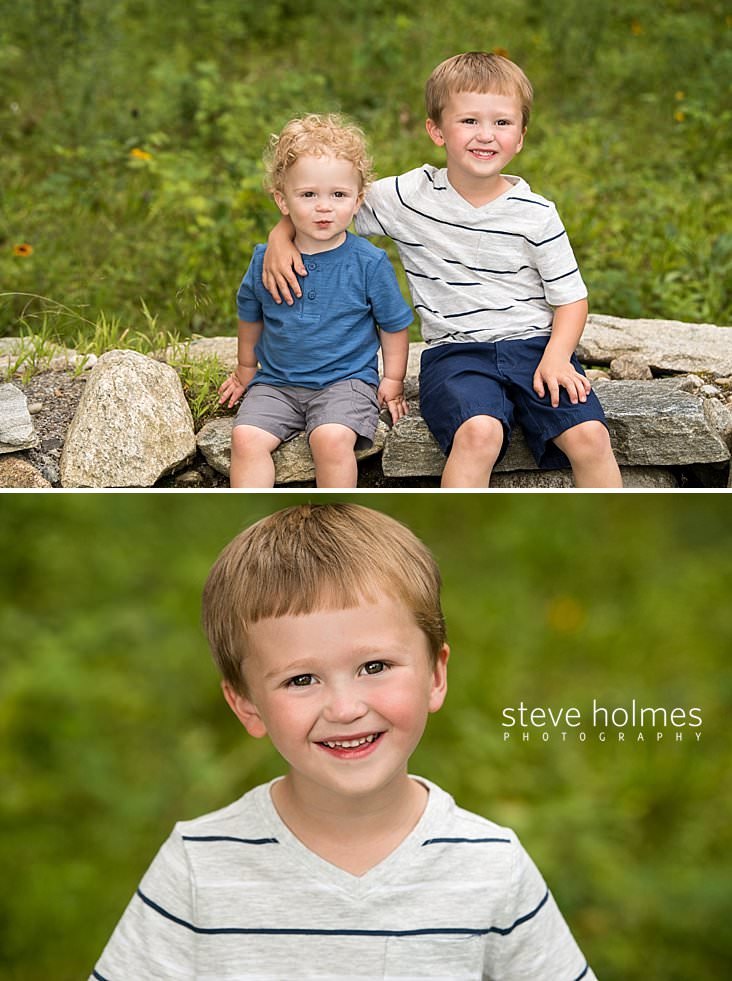 04_Big brother rests his arm on little brother's shoulder while sitting on stone wall.jpg