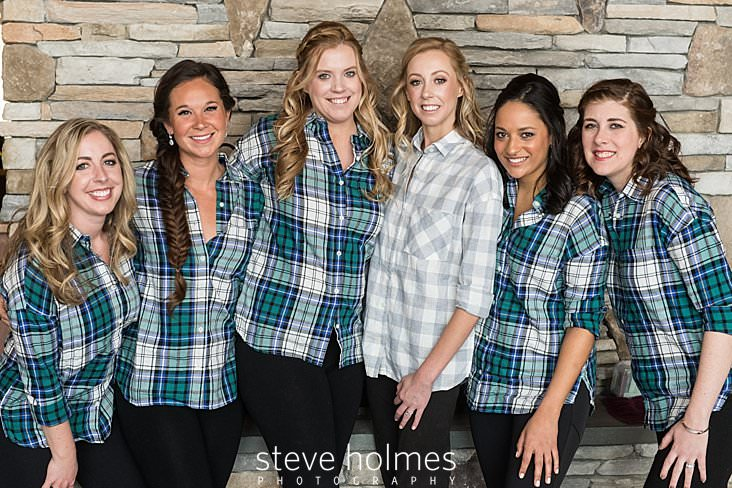 07_Bride poses with her bridesmaids all wearing plaid shirts.jpg