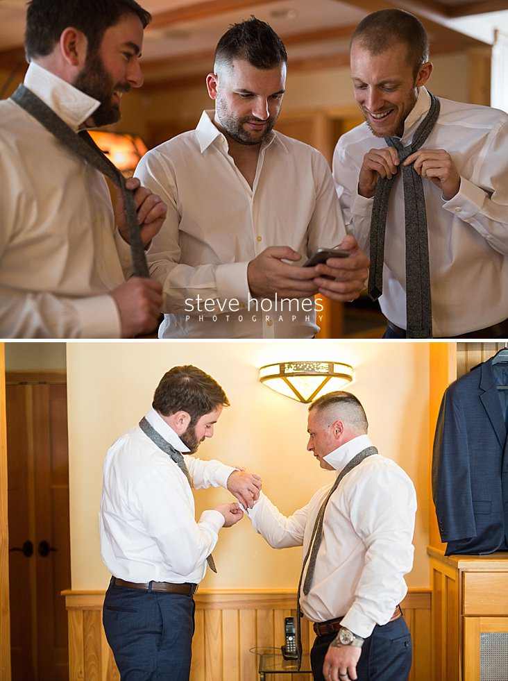 08_Groomsmen laugh together while getting dressed.jpg