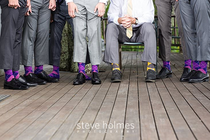 13_Groom and groomsmen show off their purple and yellow argyle socks.jpg