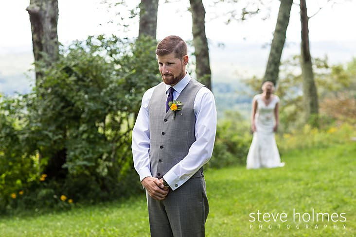 14_Groom waits as bride walks behind him for first look ceremony.jpg