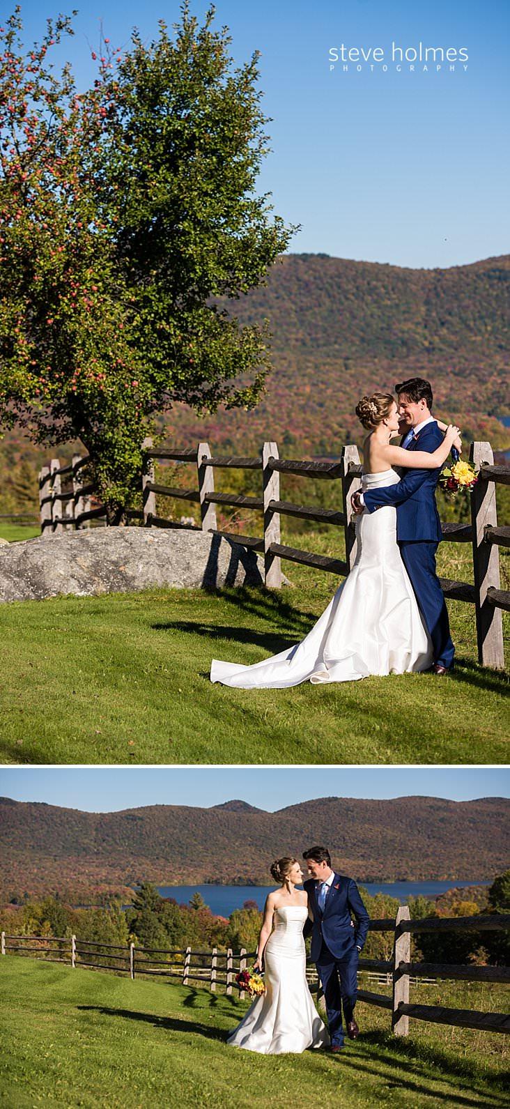 27_Bride and groom hug near fence overlooking autumn mountain landscape.jpg