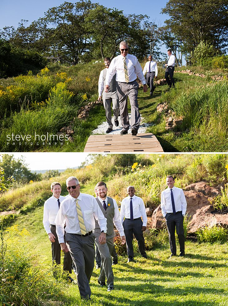 37_Groom and his father walk on path over bridge to ceremony.jpg
