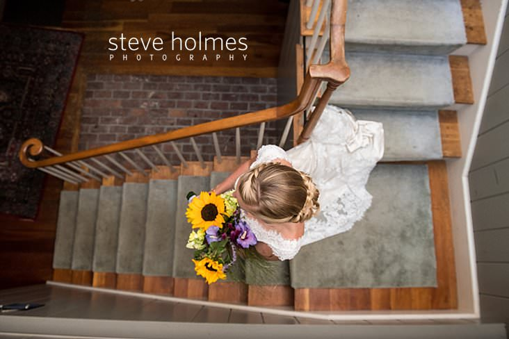 38_Bride walks down stairs on her way to ceremony.jpg
