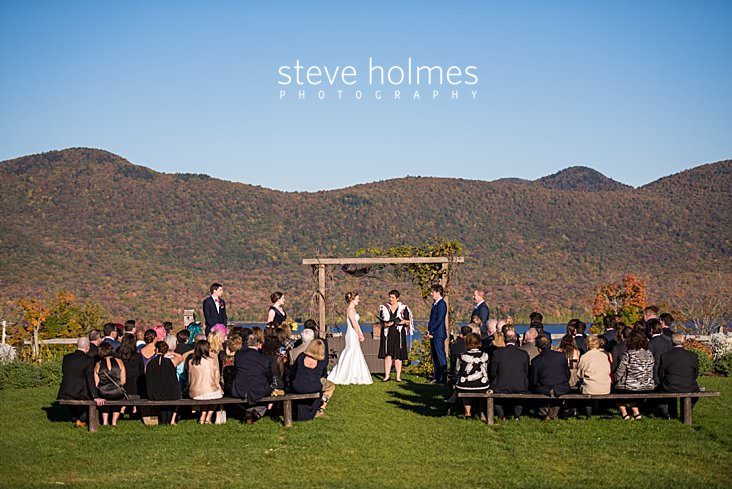 39_Outdoor wedding ceremony on hillside overlooking lake and fall colored mountains.jpg