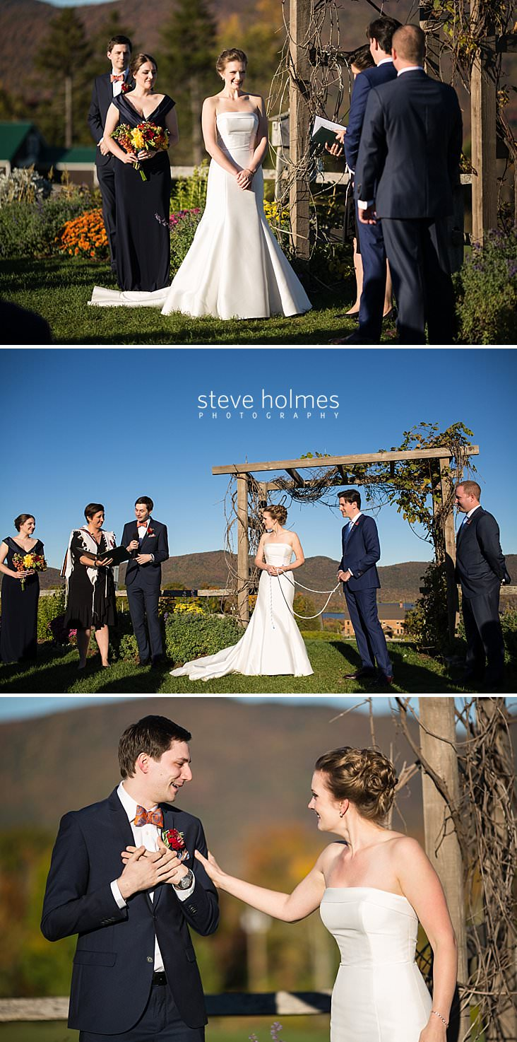 42_Bride grins at groom during ceremony.jpg