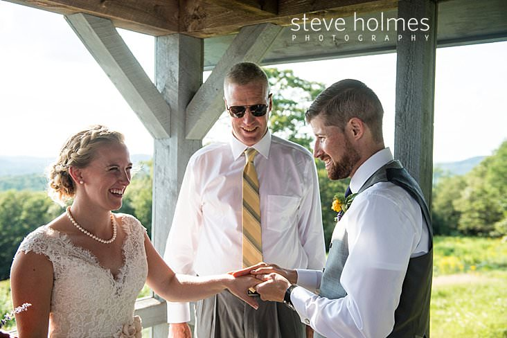 52_Bride and groom hold ring ceremony on porch of cabin.jpg
