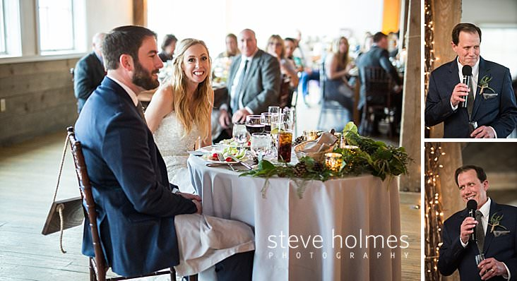 53_Bride smiles at sweetheart table during dinner.jpg