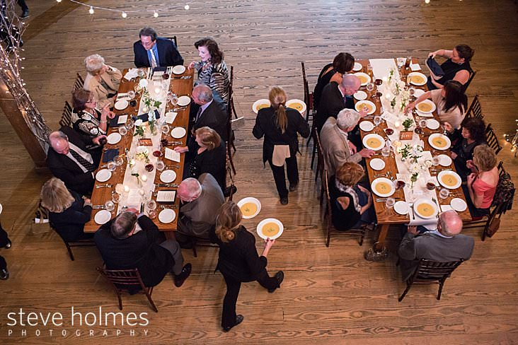 56_Birds eye view of guests being served soup during wedding reception.jpg