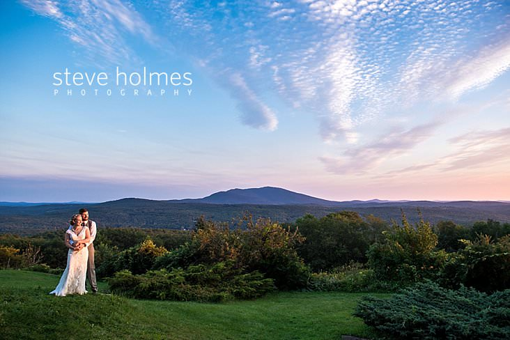 61_Bride and groom stand on ridge line overlooking Green Mountain range in late summer_.jpg
