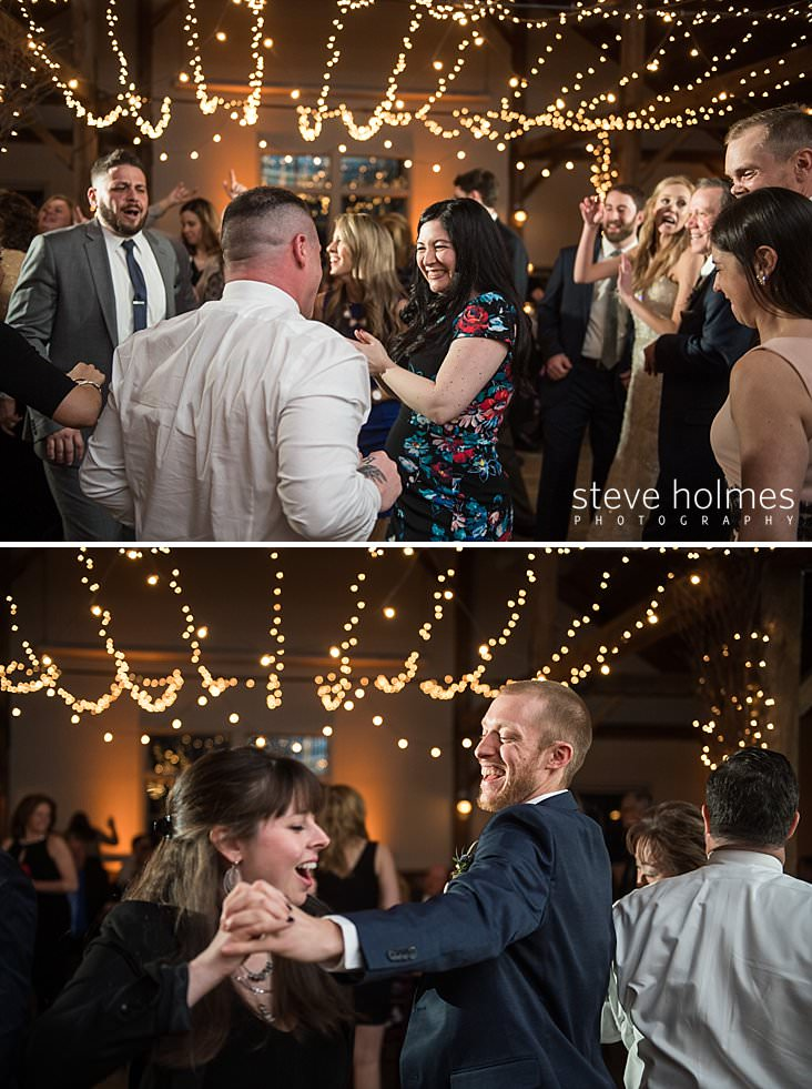 68_Guests dance under stringed lights at rustic, mountain top wedding reception.jpg