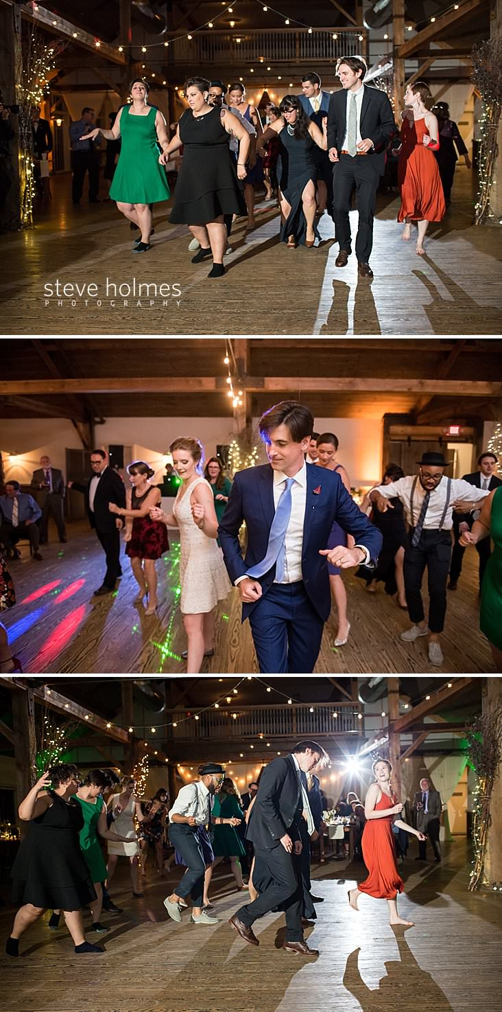 82_Wedding guests do line dance at reception.jpg