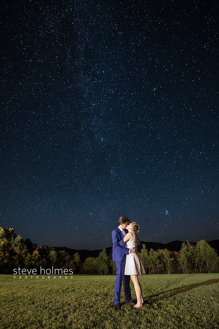 85_Bride and groom kiss under the starry skies of Vermont.jpg