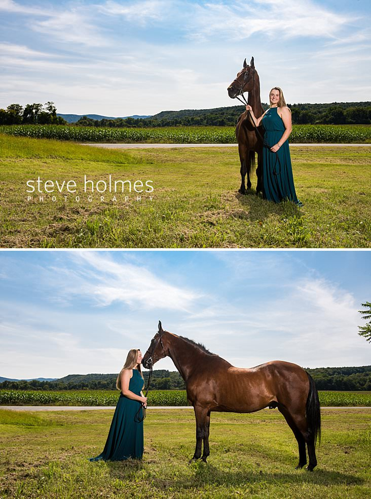 07_Senior portrait of a teen girl in blue dress standing with her horse in corn field.jpg
