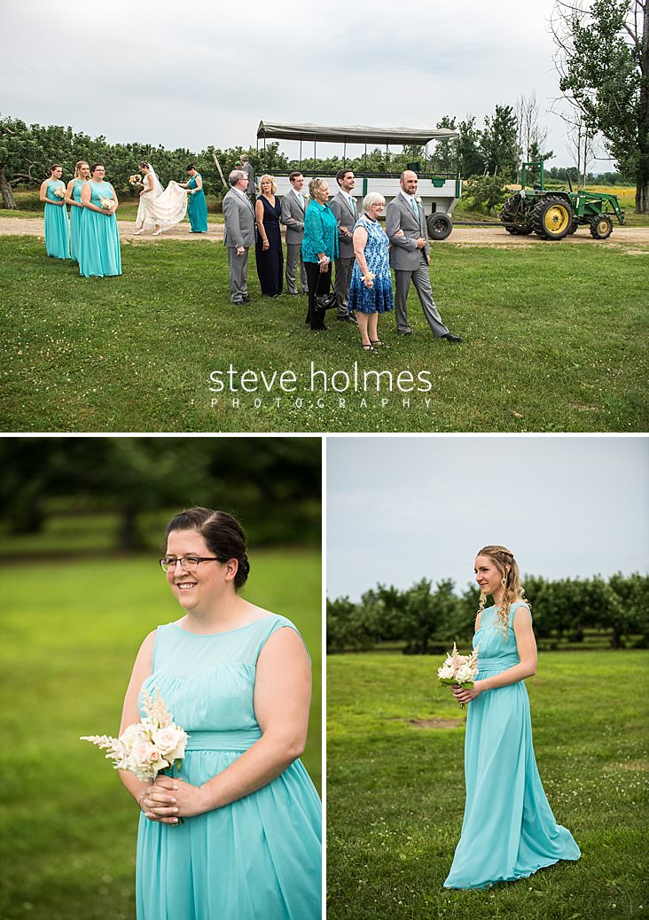 28_Bridal party lines up to walk down isle of outdoor orchard ceremony.jpg