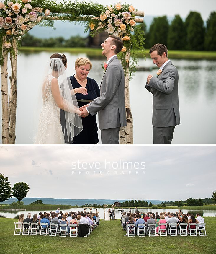 44_Groom laughs during ceremony on the banks of a pond.jpg