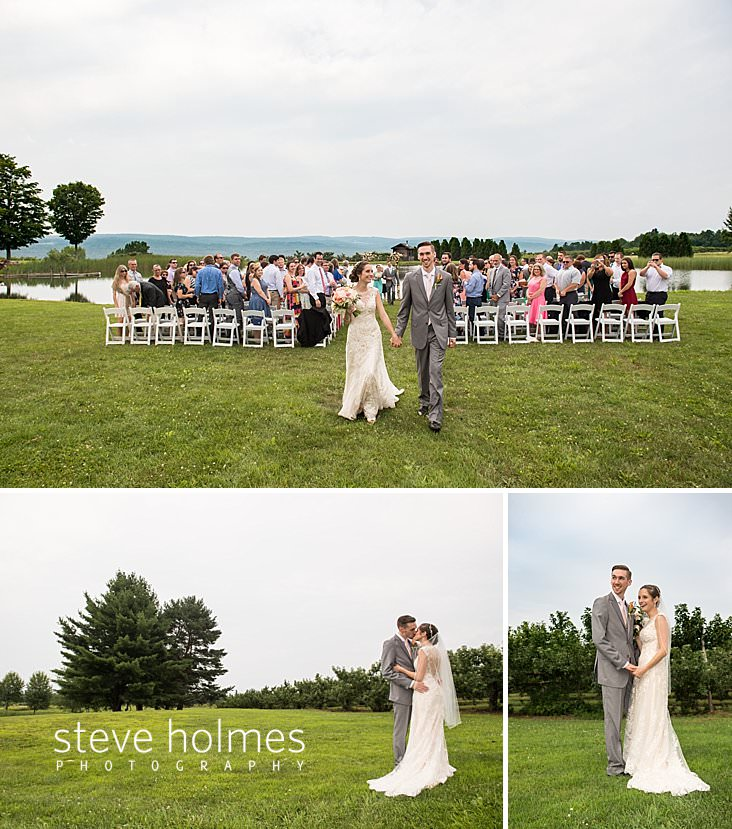 50_Standing guests turn to watch bride and groom leave outdoor ceremony.jpg