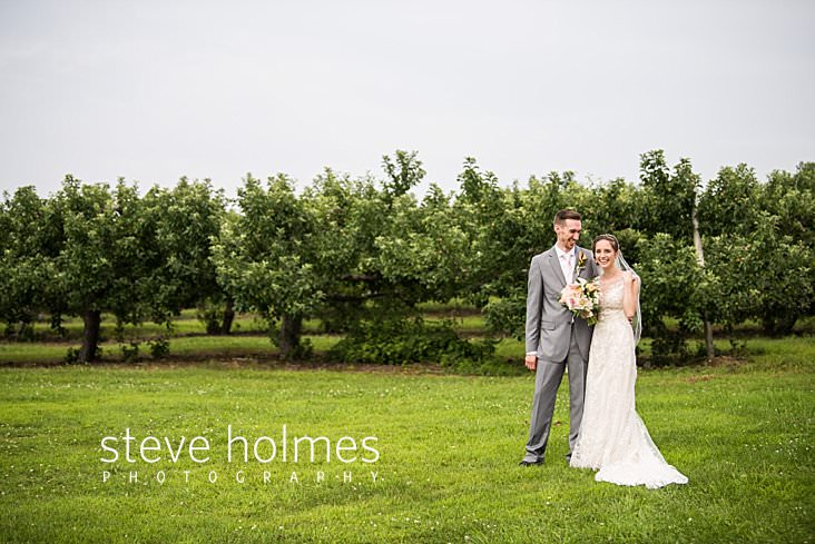 53_Bride and groom laugh in outdoor orchard portrait.jpg