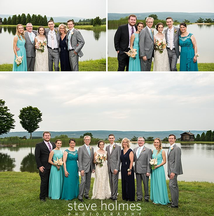 54_Bride and groom are flanked by the groom's family on the banks of a pond.jpg