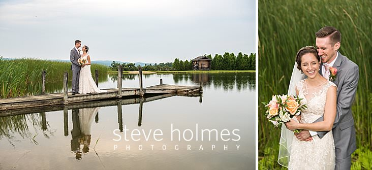 64_Bride and groom hold eachother on the dock of a summer pond.jpg