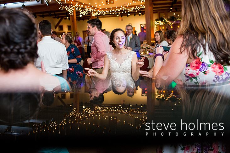 95_Bride grooves to a song during reception in stylized photo_.jpg