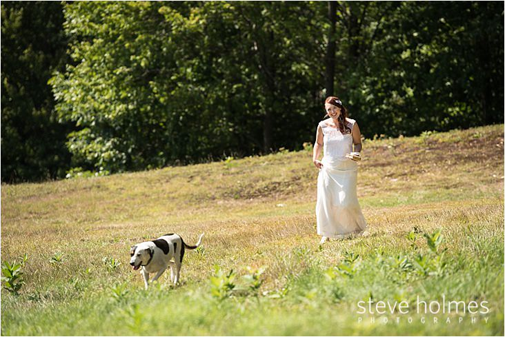 015_bride-walking-with-dog-in-field