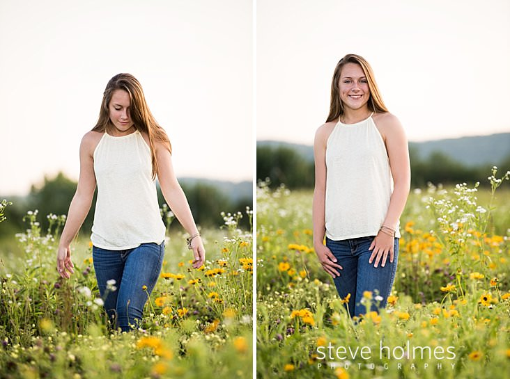 Brunette teen walks through field of wildflowers