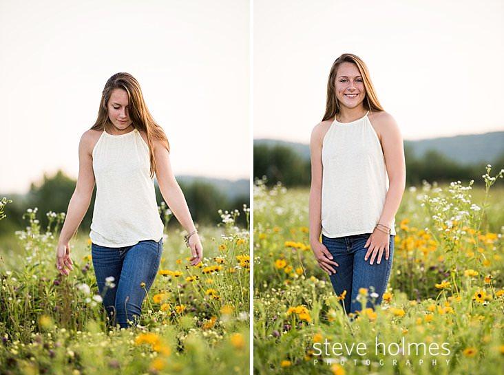 Brunette teen walks through field of wildflowers