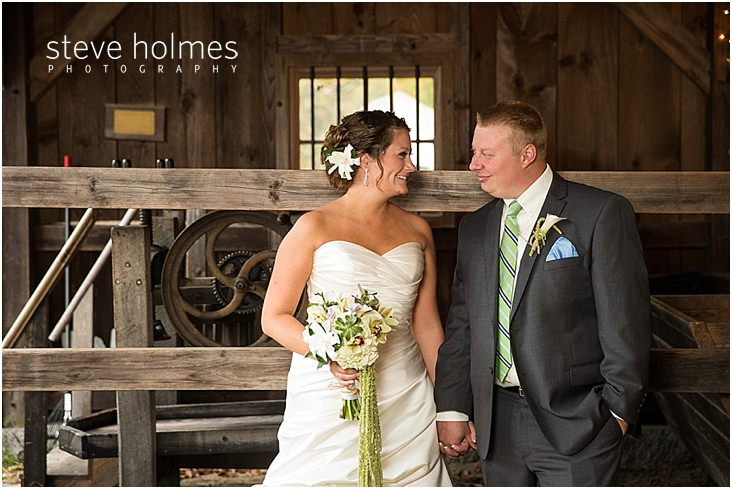 18_bride-groom-smile-at-each-other-in-barn