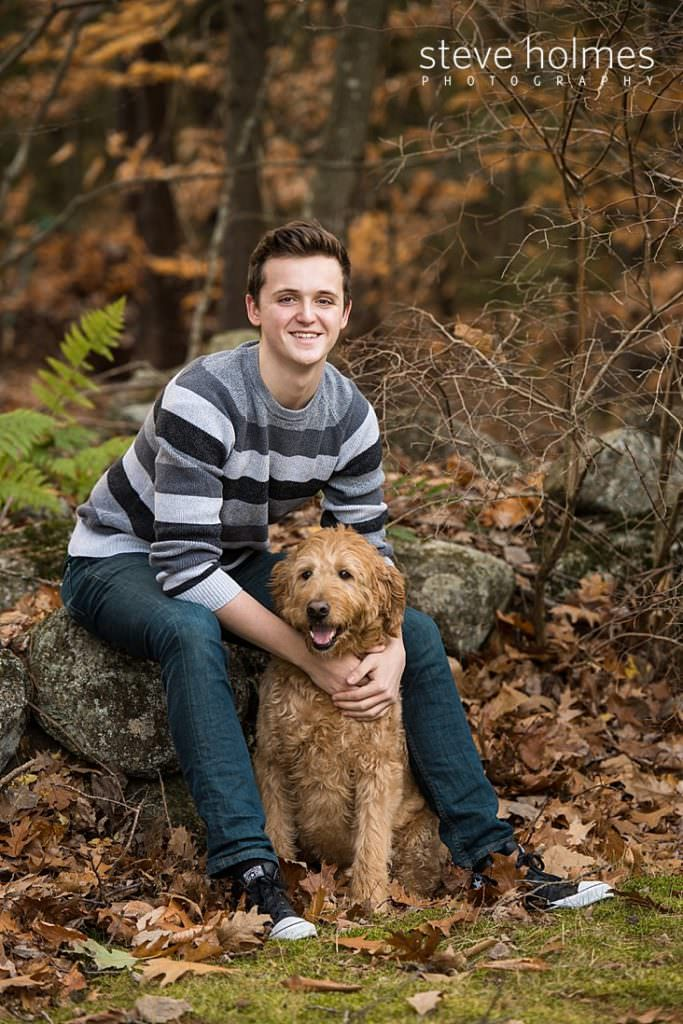Outdoor portrait of young man and his dog