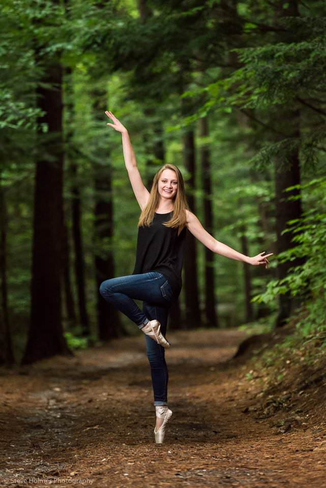 teen girl poses on path wearing ballet shoes