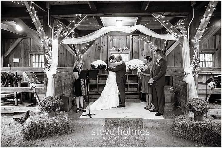 37_bride-groom-first-kiss-barn